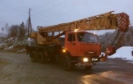 Автокран 25 тонн - 22 метра.